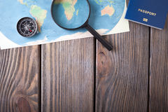Preparation for Traveling concept, passport, compass, map on a wooden background. Stock Images