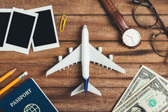 Preparation for Traveling concept, pencil, money, passport, airplane, watch, eyeglasses, photo frame. Royalty Free Stock Photo