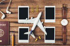 Preparation for Traveling concept, pencil, passport, airplane, watch, blank instant photographs, earphone. Royalty Free Stock Images