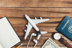 Preparation for Traveling concept, pencil, watch, money, passport, airplane, noted book, earphone. Stock Images