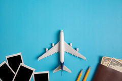 Preparation for Traveling concept, photography, airplane, money, passport, pencils, book. Royalty Free Stock Photography
