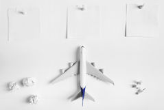Preparation for Traveling concept and to do list, blank paper noted, paper ball, airplane, push pin. Royalty Free Stock Photos