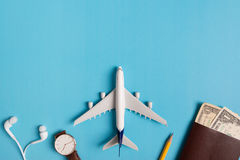 Preparation for Traveling concept, watch, airplane, money, passport, pencils, book. Stock Photo