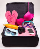 Preparation for trip concept - open suitcase full of travel item Royalty Free Stock Image