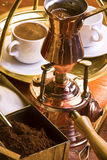 Preparation of Turkish coffee. Preparation of Turkish coffee with two cups aside Stock Images