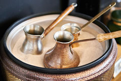 Preparation of Turkish coffee in cezve in sand Royalty Free Stock Photo