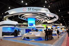 Preparation underway at ST Engineering booth at Singapore Airshow 2012 Stock Photos