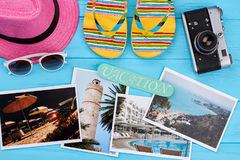 Preparation for vacation abroad. Summer accessories, pictures with resorts Stock Image