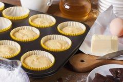 Preparation of vanilla muffins close-up  horizontal Stock Images