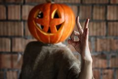 Pumpkin head monster sign hand space halloween Royalty Free Stock Images