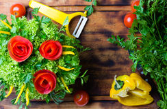 Preparation vegetable bouquet of tomatoes, lettuce, bell paper. Cutting board. Preparation vegetable bouquet of tomatoes, lettuce, bell paper. Wooden cutting Stock Photography