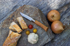 Preparation of vegetables on stone background. Picnic outdoors. Stock Photo