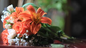 Preparation of wedding bouquet,roses and lilies on the table Stock Image