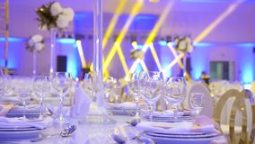 Preparation of the wedding hall bride table glass plate fork spoon stock video footage