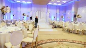 Preparation of the wedding hall bride table Lviv 25.07.2018 stock footage