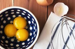 Preparation for the whisking of egg yolks Royalty Free Stock Photo