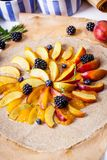 Preparation of whole-grain galette with plums, blackberries and. Preparation of whole-grain galette with plums on a white table. top view royalty free stock photography