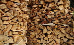 Preparation for winter. Round wood piles texture background. Wood stacking method. Firewood piles at countryside stock photo Royalty Free Stock Images