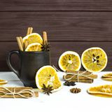 Preparation of a winter warming alcoholic beverage with spices and wine - mulled wine Royalty Free Stock Image