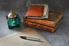 Preparation for writing of the letter. Still life in a retro style with a fountain pen, ancient books Royalty Free Stock Image