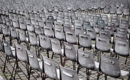 Preparations for the big audience. A perspective shot from a huge number of chairs which are set for a big show. Exterior, Daylight Royalty Free Stock Image