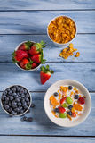 Preparations for breakfast corn flakes and fruits Stock Photo