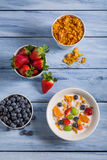 Preparations for breakfast corn flakes and fruits Royalty Free Stock Photo