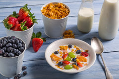 Preparations for breakfast corn flakes and fruits Stock Image