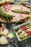 Preparations for the casserole with asparagus and cheese royalty free stock photo