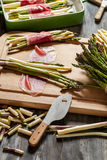 Preparations for the casserole with asparagus royalty free stock image