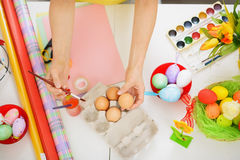 Preparations for Easter. Closeup on hands Stock Photography