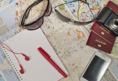 Preparations for the journey.  passport camera glasses map Royalty Free Stock Photos