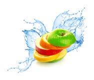 Preparato della frutta nella spruzzata dell'acqua Fotografia Stock