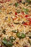 Preparazione di una paella spagnola. Fotografia Stock