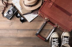 Prepare accessories and travel items on wooden board Royalty Free Stock Photography