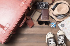 Prepare accessories and travel items on wooden board Stock Photos