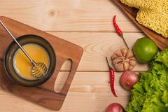 Prepare breakfast from eggs. Whipped eggs on wooden table. Stock Images