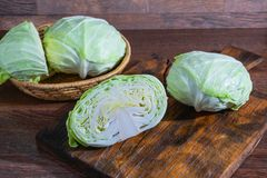 Prepare the cabbage to cook on the kitchen table stock photography