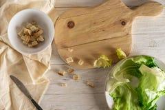 Prepare Caesar salad Royalty Free Stock Images
