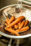 Prepare for cooking, Soak carrots in bowl with water Royalty Free Stock Image