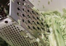 Prepare cucumber. Royalty Free Stock Image