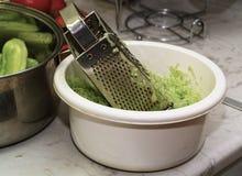 Prepare cucumber. Royalty Free Stock Photos
