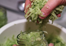 Prepare cucumber. Royalty Free Stock Photo