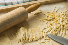 Prepare a delicious home noodles, now just cut. Royalty Free Stock Photography