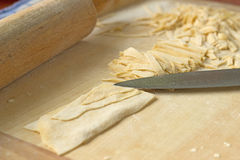 Prepare a delicious home noodles, now just cut. Stock Images