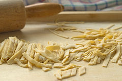 Prepare a delicious home noodles, now just cut. Royalty Free Stock Photo