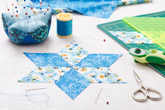 Prepare of diamond pieces of fabric for sewing quilt Stock Photography