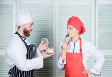 Prepare dinner for family. Menu planning. culinary cuisine. Family cooking in kitchen. man and woman chef in restaurant royalty free stock images
