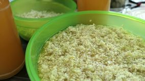 Prepare elder berry flower heads to making jam of it. mixing Elder flower heads under the apple juice. stock video footage