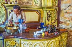 Prepare for Ethiopean coffee ceremony. KIEV, UKRAINE - JUNE 4, 2017: The first step to prepare the Ethiopian coffee ceremony is to wash green coffee beans, on Stock Photography